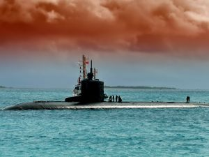 "The main advantage of a nuclear submarine is the ability to remain submerged almost indefinitely, whereas diesel boats either need to surface or extend a ""snorkel"" above the water to ""breathe."""