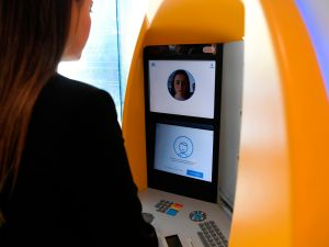 A woman uses an ATM with facial recognition technology during the presentation of the new service by CaixaBank in Barcelona on February 14, 2019.