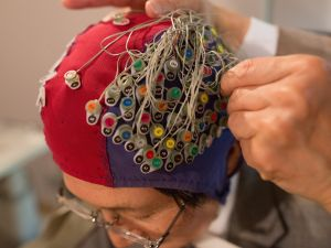 Scientists demonstrate a device capable of reading the human mind through brainwave-detecting electrodes in Japan on April 27, 2017.