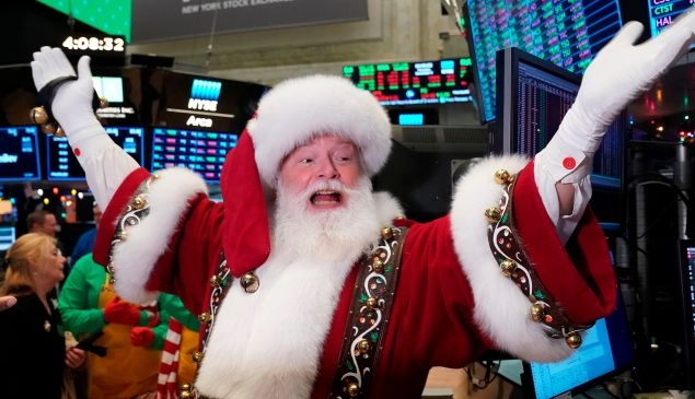 Santa Clause gestures on the floor at the closing bell of the Dow Industrial Average at the New York Stock Exchange on December 5, 2019 in New York.