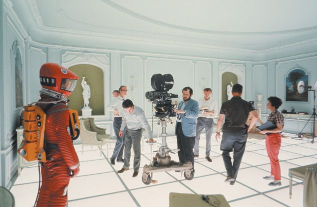 On the Hotel Room set of 2001: A Space Odyssey. Kubrick is shown at center behind the camera.
