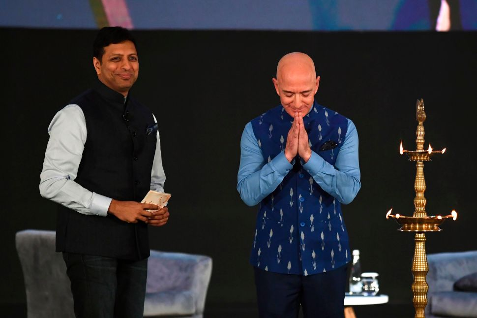 CEO of Amazon Jeff Bezos (R), along with Amit Agarwal, senior vice president and country manager for Amazon India, at Amazon's annual Smbhav event in New Delhi on January 15, 2020.