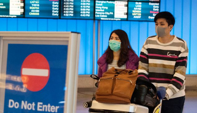 Passengers wear protective masks to protect against the spread of the Coronavirus.