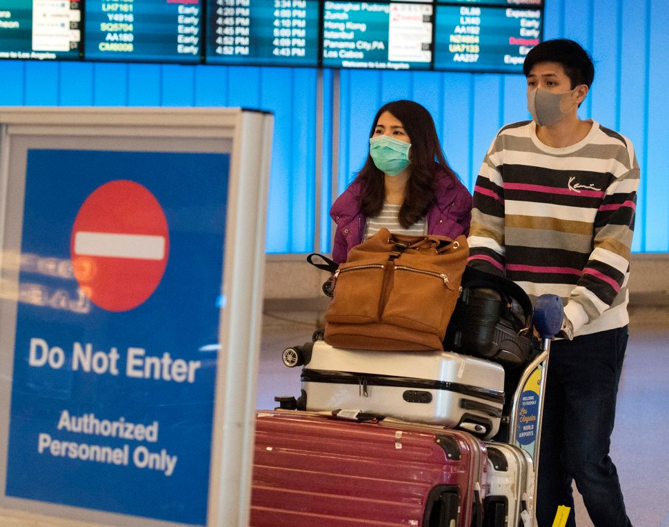 Coronavirus Is Grounding Flights Globally—Here's How to Stay Safe If You Must Travel