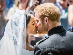 Prince Harry, Duke of Sussex kisses his wife Meghan, Duchess of Sussex