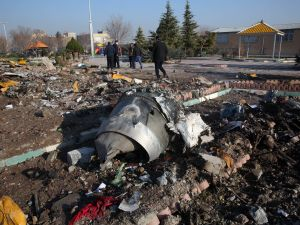 Rescue teams work amidst debris after a Ukrainian plane carrying 176 passengers crashed near Imam Khomeini airport in the Iranian capital of Tehran early in the morning on January 8, 2020, killing everyone on board.