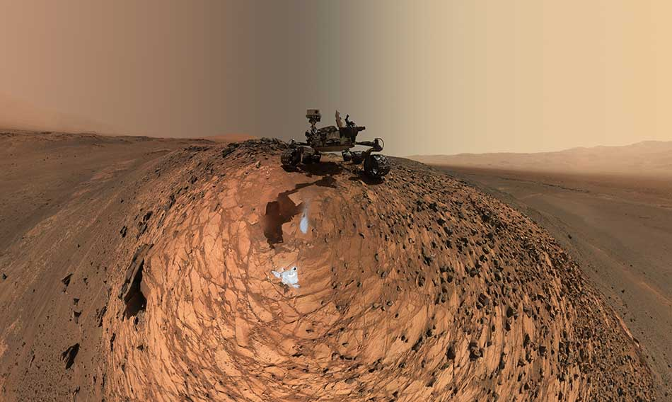 "This low-angle self-portrait of NASA's Curiosity Mars rover shows the vehicle above the ""Buckskin"" rock target, where the mission collected its seventh drilled sample."