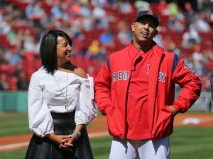 Boston Red Sox Senior Vice President, Major and Minor League Operations Raquel Ferreira has a light moment with Sox manager Alex Cora, right.