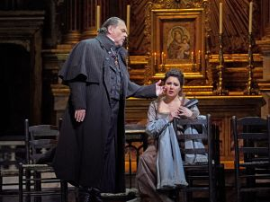 "Michael Volle as Scarpia and Anna Netrebko in the title role of Puccini's ""Tosca."""