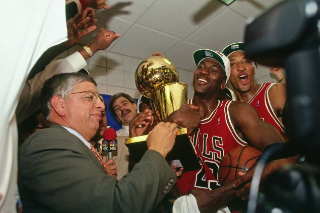 David Stern presents Michael Jordan and the Chicago Bulls the championship trophy after the Bulls defeated the Phoenix Suns