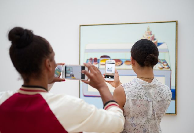 Visitors at the Museum Voorlinden in the Netherlands photograph a work of art.