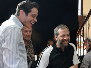 Pete Davidson and director Judd Apatow with crew members on the set of The King of Staten Island