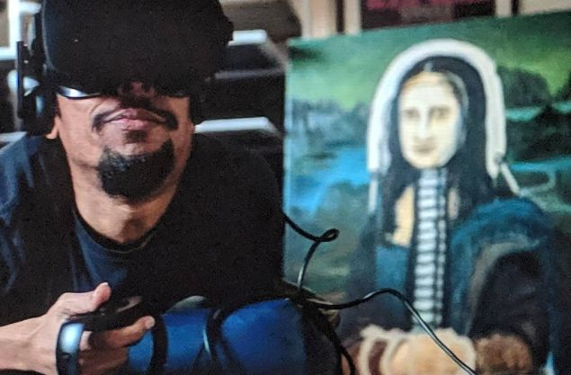 An artist uses a VR headset while adapted version of The Mona Lisa is seen in the background.