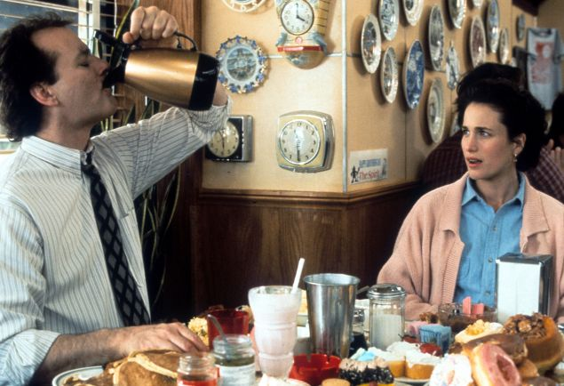 Bill Murray puts down a pitcher of coffee with Andie MacDowell in a scene from the film Groundhog Day