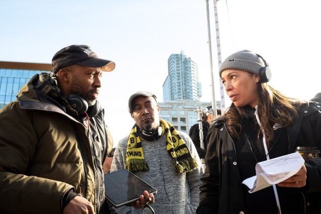 Writer Maurice Marable (left) and writer and cartoonist Keith Knight (center) on the set of Woke
