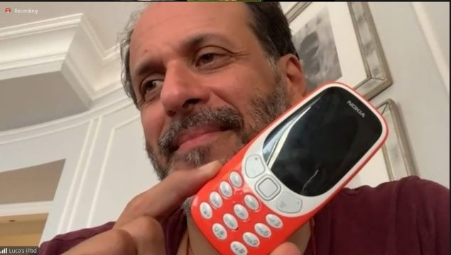 Luca Guadagnino shows us his phone over Zoom