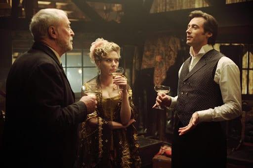 John Cutter (Michael Caine), Olivia Wenscombe (Scarlett Johannson) and Robert Angier (Hugh Jackman) in The Prestige