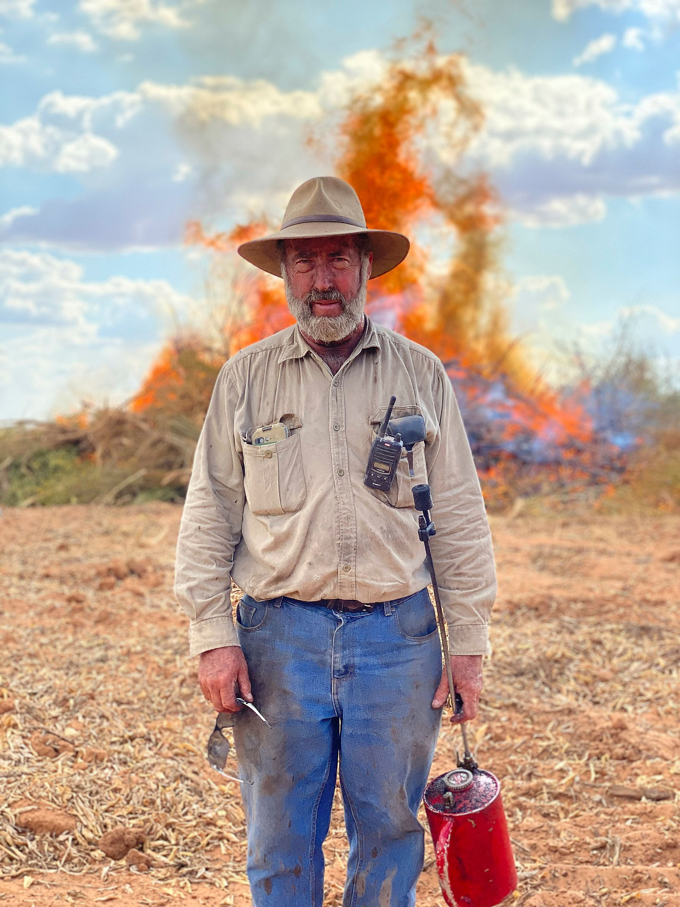 """A Farmer in JR's piece """"Homily to Country"""" in front of wildfires"""