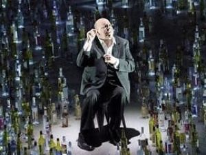 The aging poet (Uwe Schönbeck) reflects on his life in 'Les Contes d'Hoffmann'.