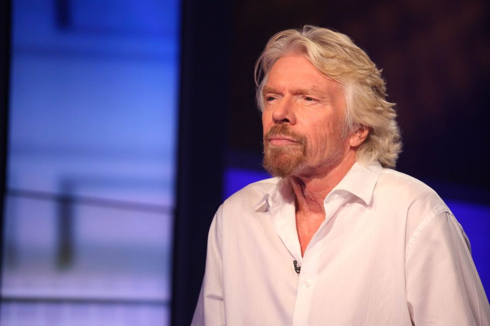 Richard Branson, Travel Moguls Counting On Unlikely 'Vaccine Passport' For Recovery