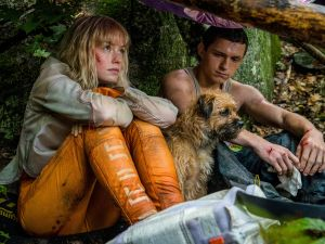 Daisy Ridley as 'Viola Eade,' Manchee the dog, and Tom Holland as 'Todd Hewitt' in CHAOS WALKING.