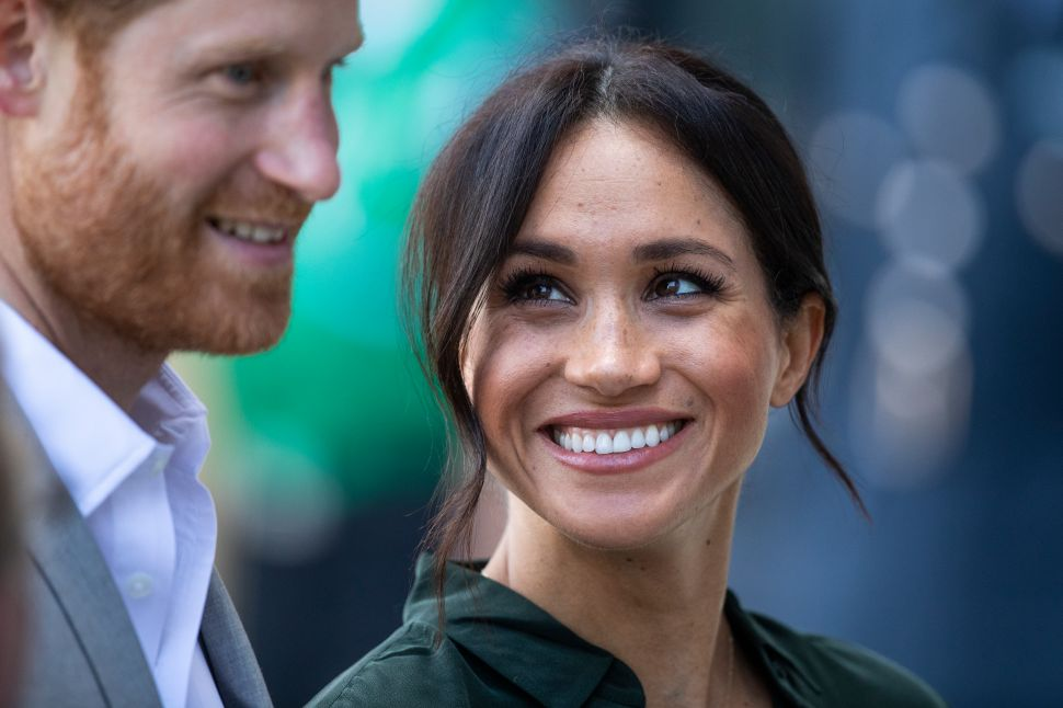 Why Meghan Markle Isn't Joining Prince Harry in the U.K. Next Month
