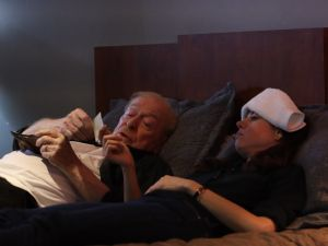 Michael Caine and Aubrey Plaza in the film Best Sellers