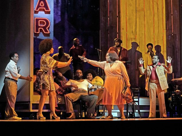 """Latonia Moore (center) as Billie tracks down her unfaithful husband in a Louisiana honky tonk in a scene from """"Fire Shut Up My Bones."""""""